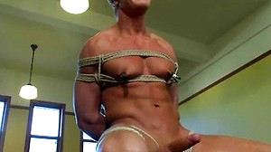 Blond surfer stud is tied up and edged repeatedly until he's pissed off.
