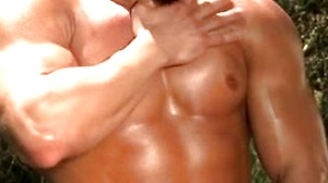 Contemplating his bulging muscles, he just pleasures himself